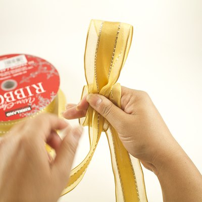 Be sure that the shiny side of the ribbon faces outward.