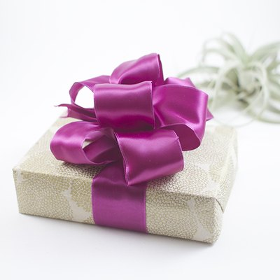 A gift bow dresses up any gift.