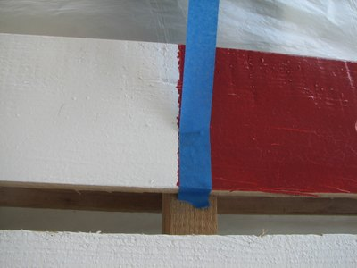 Reapply painter's tape for a crisper edge.
