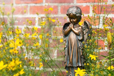 Clean your garden statues to keep them looking their best.