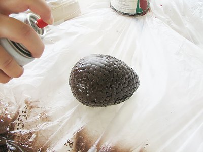 Spray the egg with the texturizing spray paint.