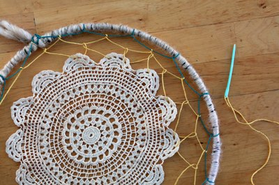 Weave the doily into your web.