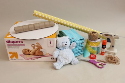 Gather all your materials to make the diaper cake.