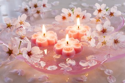 Romantic candles and flower blossoms.