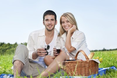 Couple with wine on romantic picnic