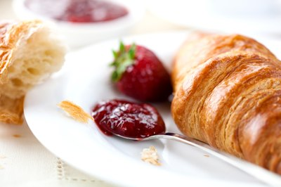 Croissant with fruit and jam