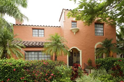 A Mediterranean style home with wood trim.