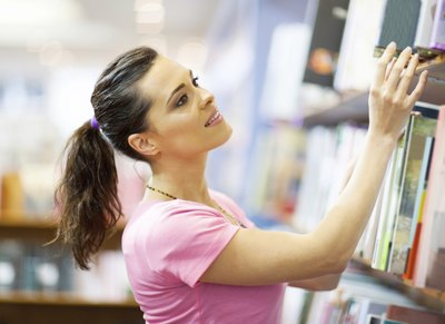 Woman browsing books at store