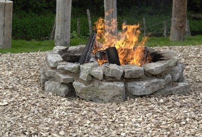 Fire pits provide a focal point for outdoor entertaining. - The Most Popular Rocks For Fire Pits (with Pictures) EHow