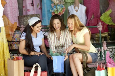 Women looking in gift bag at shop