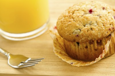 Muscadine muffin beside glass of orange juice