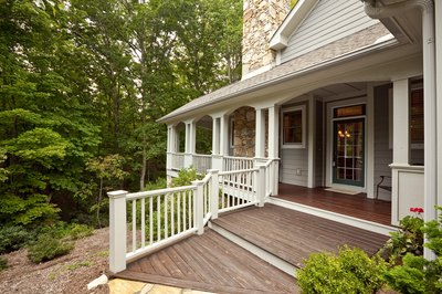 A porch or deck can make your doorway look more visually appealing.
