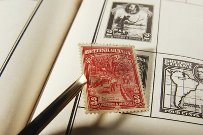 Stamp being placed in collector's book