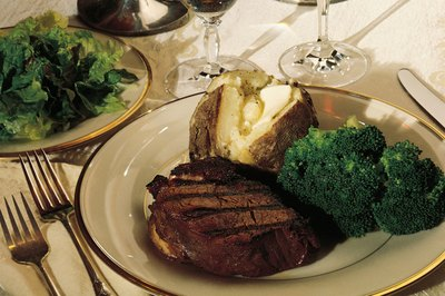 Serve a family-style meal with steak and baked potatoes.