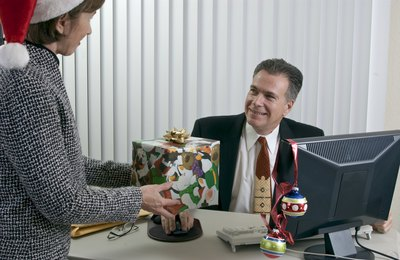 Man receiving appreciation gift at Christmas