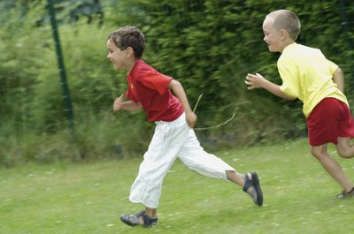 Boys running on grass.