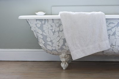 Towel laying on side of tub