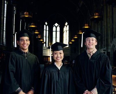 Three esteemed graduates wear white tassles.