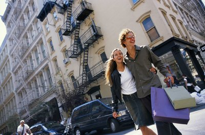 A young couple shops together in the city.