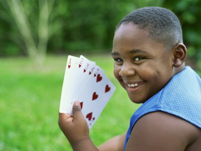 child with playing cards