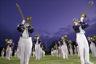 Highschool marching band on football field