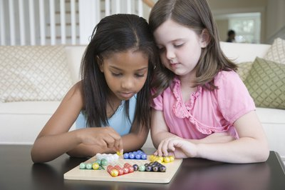 Girls playing board game