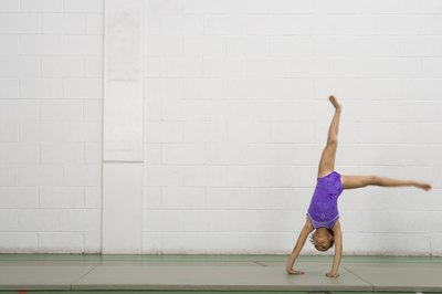 young girl doing cartwheel