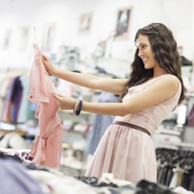 Woman shopping at clothing store