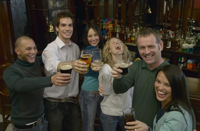 Friends toasting at Saint Patrick's day pub party