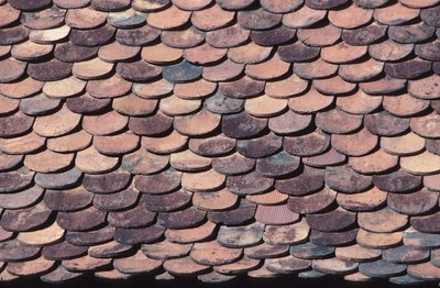 Roofing tiles overlap so that water cannot leak through a seam.