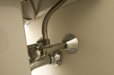 Bathroom pipes and valves.