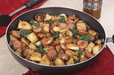 Sausage and potatoes in a pan.
