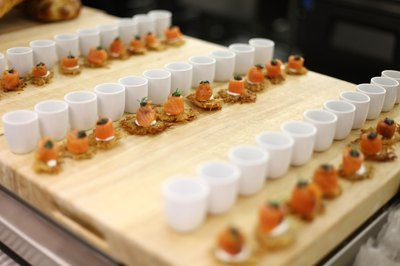 Smoked salmon, caviar, dill-sour cream, potato cake appetizer at culinary event