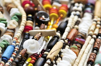African people also make beads out of natural materials like bone, hell, wood, amber and glass.