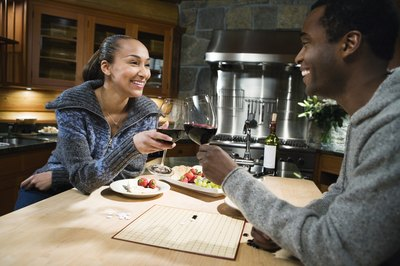 A couple toast with red wine