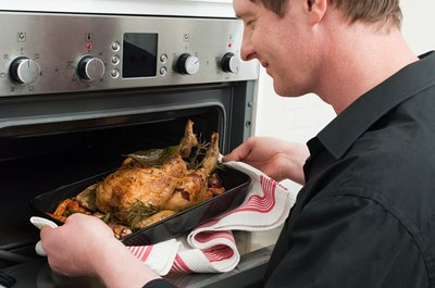 Cook it until the internal temperature of the thigh's thickest portion reaches 180 degrees Fahrenheit.