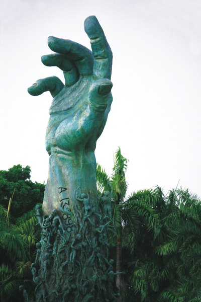 A green patina can form on a bronze sculpture over a long period of time.