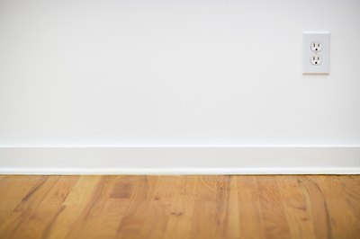 Light or medium oak floors look good with white or off-white paint.