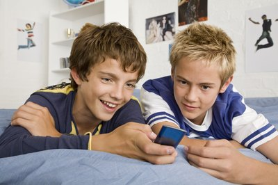 Teenage boys looking at iPod Nano