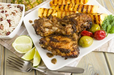 Plate of jerk chicken and grilled pineapple