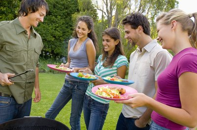 man barbequeing for guests