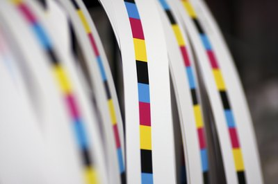CMYK test strips near printing press