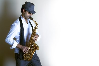 A jazz saxophonist wearing dark sunglasses.