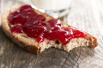 Toasted bread with jam spread on top