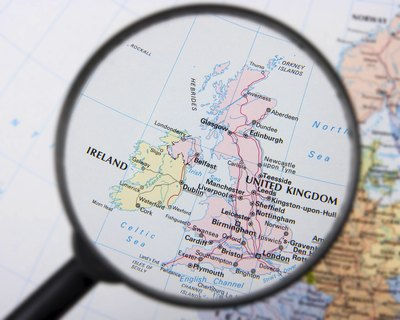 Magnifying glass over map of the UK