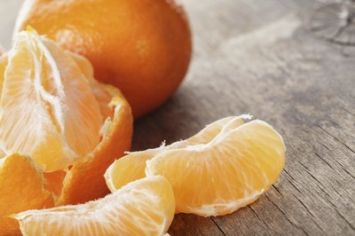 A close-up of a peeled mandarin orange.