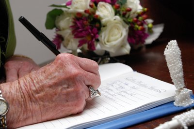 older woman writing on piece of paper