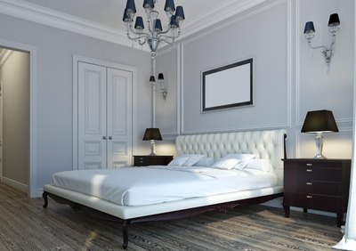 White or off-white bedroom walls are classic colors which will open up any room