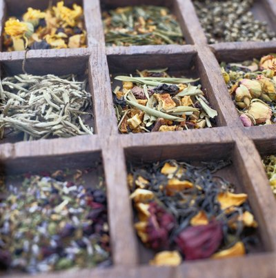 Assemble a basket full of a variety of teas and coffee blends.