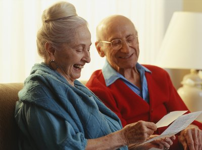 old couple reading an old travel letter